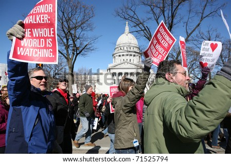 MADISON, WI-FEB 19: Opponents march in protest of Gov Scott Walker's bill to take away the bargaining rights of public workers on February 19, 2011 in Madison, Wisconsin. - stock photo