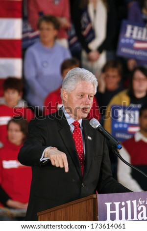 MADISON, WI-FEB. 14:President Bill Clinton speaks to supporters during a speech in support of Hillary Clinton's Democratic presidential primary nomination on February 14, 2008 in Madison, WI. - stock photo
