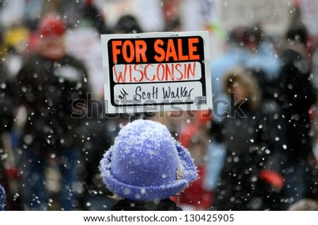 MADISON, WI - FEB 26:Protester in Wisconsin during a rally against Governor Scott Walker's budget bill on Feb 26, 2011. Walker has won the recall election, but he still faces a new election next year - stock photo