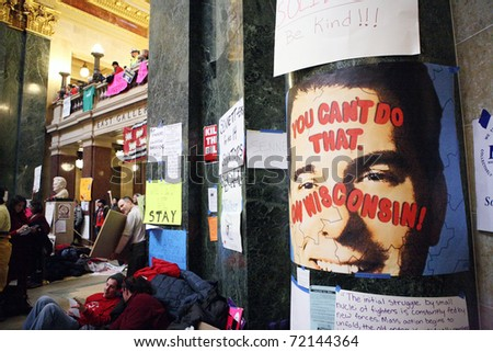 MADISON, WI - FEB 21: Signs of protest against Gov Walker cover the walls of the Wisconsin Capitol Feb 21, 2011 in Madison Wisconsin. - stock photo