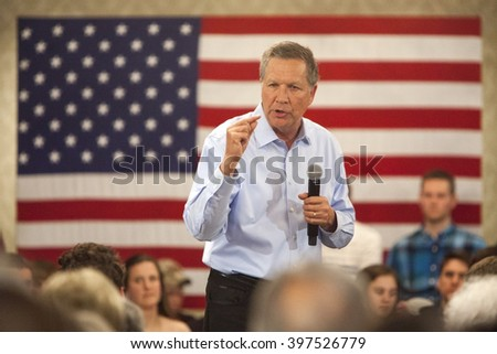 MADISON, WI/USA - March 28, 2016: Republican presidential candidate John Kasich speaks to a group of supporters during a town hall before the Wisconsin presidential primary in Madison, Wisconsin. - stock photo