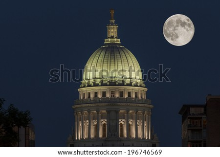 Madison, Wisconsin - Wisconsin State Capitol at night with full moon - stock photo