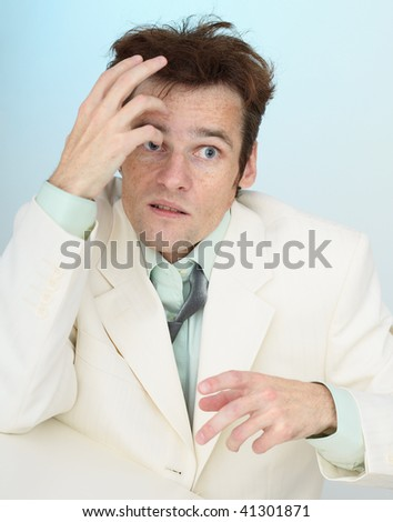 Madly frightened tousled young amusing businessman - stock photo