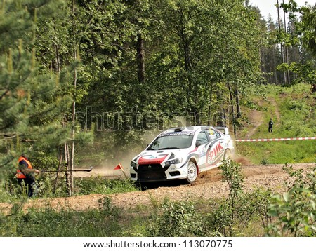 MADONA, LATVIA-JUNE 9: Alexander Mikhailov and Normunds Kokins drives Mitsubishi Lancer Evo during a motoring event Rally Madona 2012 in Madona, Latvia on June 09, 2012.