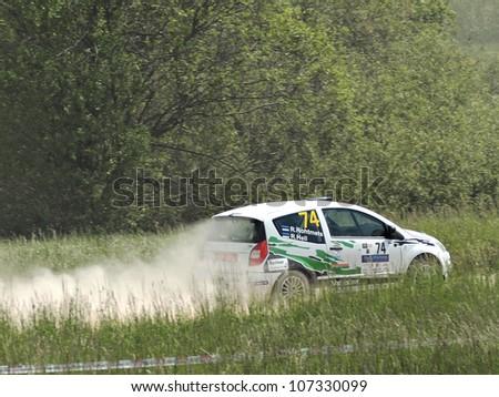 MADONA, LATVIA-JUNE 9 : Rainer Rohtmets and Rivo Hell drives Citroen C2R2Max on motoring events in Latvia - Rally Madona 2012 09 June 2012 - Madona, Latvia - stock photo