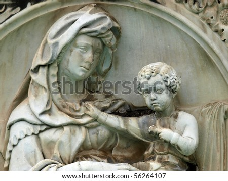Madonna and Child . Panel of the Fonte Gaia (Fountain of Joy), Piazza del Campo, Siena.