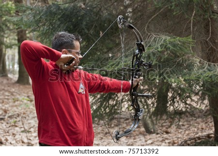 MADONNA DEL SASSO,ITALY - APRIL 17: Mauro Bonetti 01 Verb takes aim with a compound during field archery selection for italian championship, competition held on april 17, 2011 in  Novara