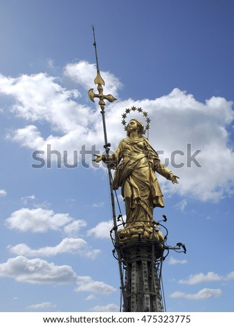 Madonnina gold statue on top of Milan Cathedral