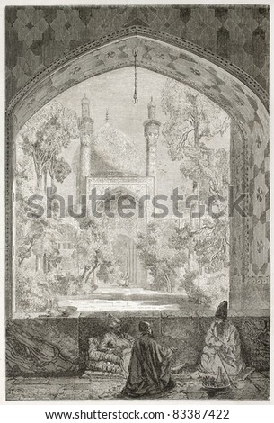 Madreseh Madar-e Shah old view trough an arched window, Ispahan. Created by Laurens, published on Le Tour du Monde, Paris, 1860 - stock photo