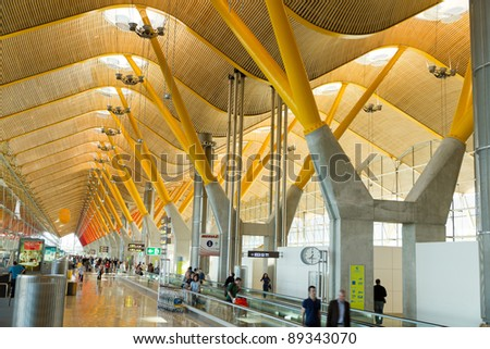 MADRID - APRIL 25: New terminal T4 at Barajas airport on April 25, 2011 in Madrid, Spain. It opened 2006 and is Madrid's largest airport with 5930 acres of space making it the 2nd largest airport in the world serving 49 million passengers per year.