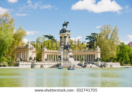 MADRID - APRIL 20: People enjoy spring evening in Buen Retiro park on April 20, 2012 in Madrid, Spain. Buen Retiro park is the largest park of the city of Madrid.