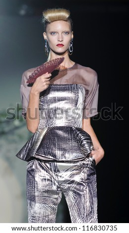 MADRID - AUGUST 31: A model walks on the Roberto Verino catwalk during the Cibeles Madrid Fashion Week runway on August 31, 2012 in Madrid. - stock photo