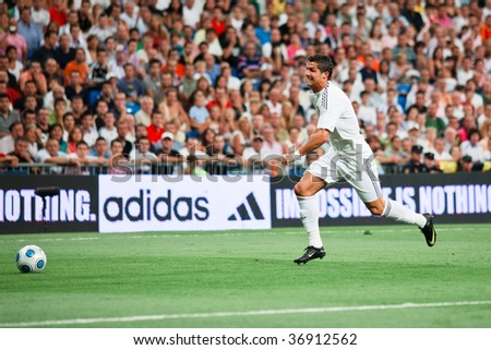 MADRID - AUGUST 24: Cristiano Ronaldo of Real Madrid chases a pass without success during Real Madrid's 4-0 victory over Rosenborg BK in the Trofeo Santiago Bernabeu August 24, 2009 in Madrid. - stock photo