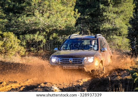 MADRID - DECEMBER 8, 2014: Renault Duster 4x4 AT at the first test-drive event. Renault Duster is a compact SUV with great off-road capabilities.  - stock photo