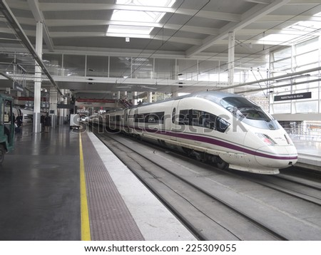 MADRID �¢?? FEB 21: High speed train in Atocha Station on February 21, 2013 in Madrid, Spain. Spain's main cities are connected by high-speed trains. - stock photo