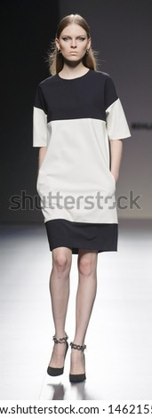 MADRID - FEBRUARY 19: A model walks on the Angel Schlesser catwalk during the Cibeles Madrid Fashion Week runway on February 19, 2013 in Madrid.