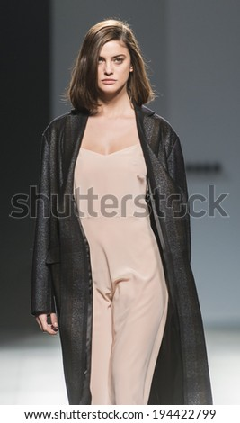MADRID - FEBRUARY 15: a model walks on the Angel Schlesser catwalk during the Mercedes-Benz Fashion Week Madrid Fall/Winter 2014-2015 runway on February 15, 2014 in Madrid.