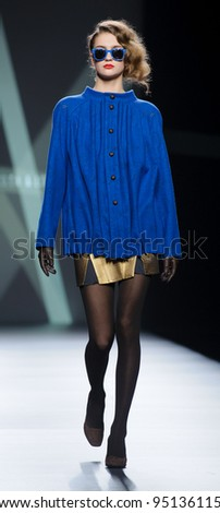 MADRID – FEBRUARY 01: A model walks on the Devota & Lomba catwalk during the Mercedes-Benz Fashion Week Madrid runway on February 01, 2012 in Madrid, Spain. - stock photo