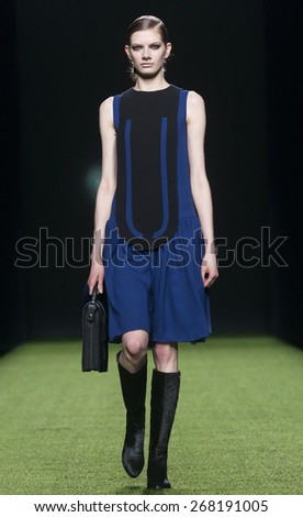 MADRID - FEBRUARY 09: a model walks on the Devota & Lomba catwalk during the Mercedes-Benz Fashion Week Madrid Fall/Winter 2015 runway on February 09, 2015 in Madrid.  - stock photo