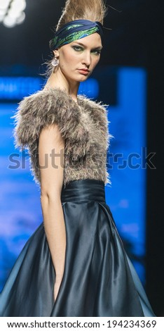 MADRID - FEBRUARY 15: a model walks on the Francis Montesinos catwalk during the Mercedes-Benz Fashion Week Madrid Fall/Winter 2014-2015 runway on February 15, 2014 in Madrid.  - stock photo