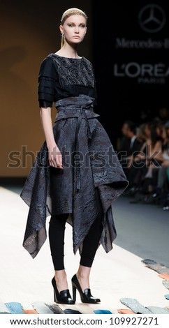 MADRID - FEBRUARY 01: A model walks on the Jesus del Pozo catwalk during the Mercedes-Benz Fashion Week Madrid runway on February 01, 2012 in Madrid, Spain.