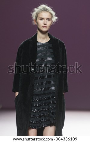 MADRID - FEBRUARY 08: a model walks on the Juan Vidal catwalk during the Mercedes-Benz Fashion Week Madrid Fall/Winter 2015 runway on February 08, 2015 in Madrid.  - stock photo