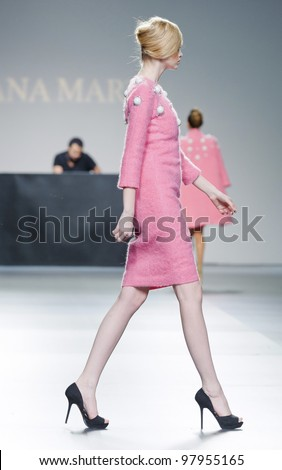 MADRID - FEBRUARY 03: A model walks on the Juana Martin catwalk during the Mercedes-Benz Fashion Week Madrid runway on February 03, 2012 in Madrid, Spain. - stock photo