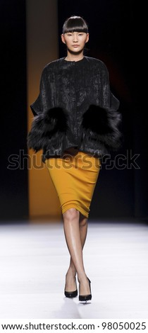 MADRID - FEBRUARY 02: A model walks on the Juanjo Oliva catwalk during the Mercedes-Benz Fashion Week Madrid runway on February 02, 2012 in Madrid, Spain. - stock photo