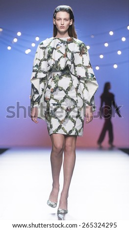 MADRID - FEBRUARY 08: a model walks on the Luke Leandrocano catwalk during the Mercedes-Benz Fashion Week Madrid Fall/Winter 2015 runway on February 08, 2015 in Madrid.  - stock photo