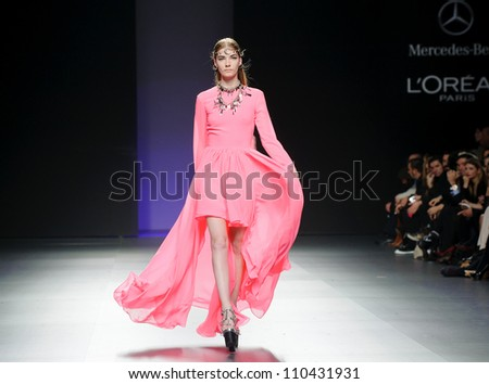 MADRID - FEBRUARY 04: A model walks on the Maria Escote catwalk during the Mercedes-Benz Fashion Week Madrid runway on February 04, 2012 in Madrid, Spain. - stock photo