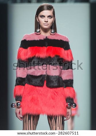 MADRID - FEBRUARY 10: a model walks on the Maria Escote catwalk during the Mercedes-Benz Fashion Week Madrid Fall/Winter 2015 runway on February 10, 2015 in Madrid.  - stock photo