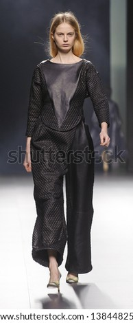 MADRID - FEBRUARY 21: A model walks on the Martin Lamothe catwalk during the Cibeles Madrid Fashion Week runway on February 21, 2013 in Madrid.