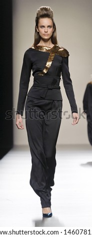 MADRID - FEBRUARY 18: A model walks on the Miguel Palacio catwalk during the Cibeles Madrid Fashion Week runway on February 18, 2013 in Madrid.