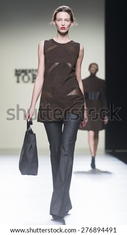 MADRID - FEBRUARY 08: a model walks on the Roberto Torretta catwalk during the Mercedes-Benz Fashion Week Madrid Fall/Winter 2015 runway on February 08, 2015 in Madrid.  - stock photo