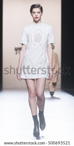 MADRID - FEBRUARY 21: a model walks on the Roberto Torretta catwalk during the Mercedes-Benz Fashion Week Madrid Fall/Winter 2016 runway on February 21, 2016 in Madrid.