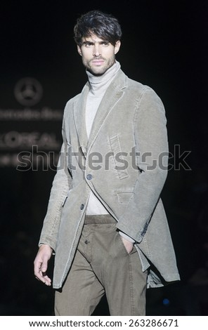 MADRID - FEBRUARY 07: a model walks on the Roberto Verino catwalk during the Mercedes-Benz Fashion Week Madrid Fall/Winter 2015 runway on February 07, 2015 in Madrid.  - stock photo