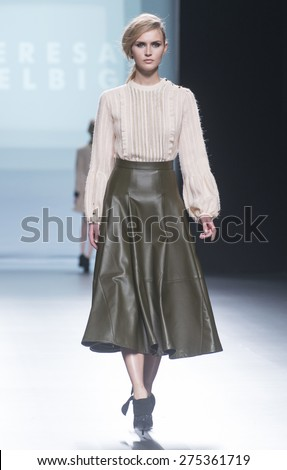 MADRID - FEBRUARY 07: a model walks on the Teresa Helbig catwalk during the Mercedes-Benz Fashion Week Madrid Fall/Winter 2015 runway on February 07, 2015 in Madrid.  - stock photo