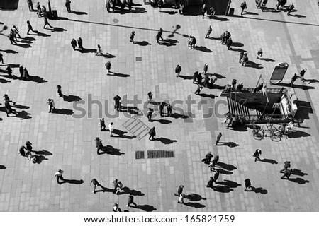 MADRID,  FEBRUARY 23: Black and white eagle-eye view of tourist and locals passing by Callao Square in Madrid, on February 23, 2013. This square is one of the busiest places in the city. - stock photo