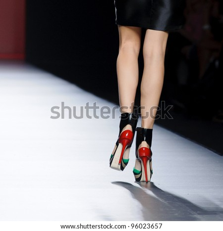 MADRID – FEBRUARY 02: Detail of shoes on the Amaya Arzuaga catwalk during the Mercedes-Benz Fashion Week Madrid runway on February 02, 2012 in Madrid, Spain. - stock photo