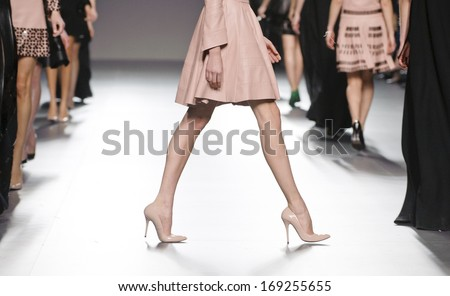 MADRID - FEBRUARY 18: Details of shoes and dresses on the Teresa Helbig catwalk during the Cibeles Madrid Fashion Week runway on February 18, 2013 in Madrid.  - stock photo