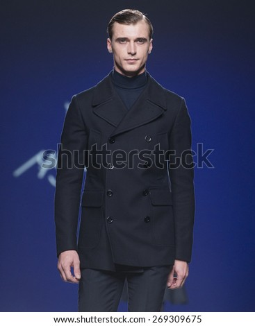 MADRID - FEBRUARY 09: french model Clement Chabernaud walks on the Miguel Vieira catwalk during the Mercedes-Benz Fashion Week Madrid Fall/Winter 2015 runway on February 09, 2015 in Madrid.  - stock photo