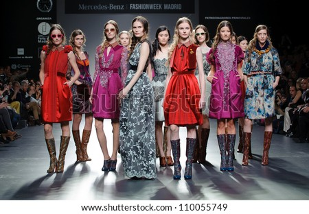 MADRID - FEBRUARY 01: Models walk on the Victorio & Lucchino catwalk during the Mercedes-Benz Fashion Week Madrid runway on February 01, 2012 in Madrid, Spain. - stock photo