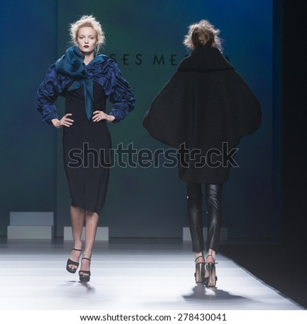 MADRID - FEBRUARY 09: models walking on the Ulises Merida catwalk during the Mercedes-Benz Fashion Week Madrid Fall/Winter 2015 runway on February 09, 2015 in Madrid.  - stock photo