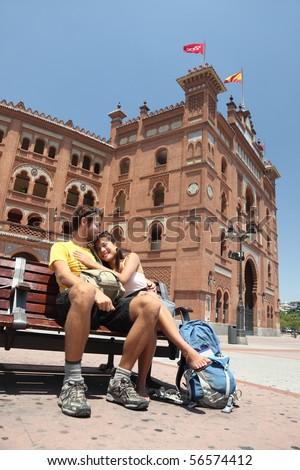 Madrid. Happy couple travelling in Spain, in front of the bullfighting arena Plaza de Toros de Las Ventas in Madrid. - stock photo