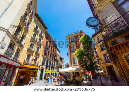 MADRID - JUNE,18: Tourists visit famous place Calle Postas on June 18, 2015 in Madrid - stock photo