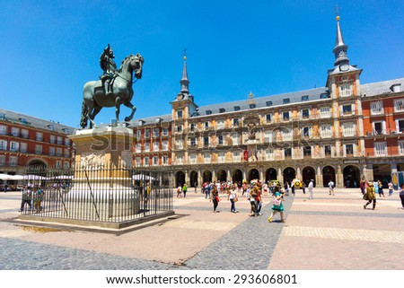 MADRID - JUNE,18: Tourists visit famous place Plaza Mayor on June 18, 2015 in Madrid - stock photo