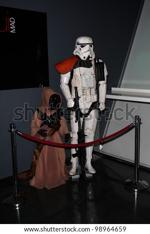 MADRID - MARCH 28: Jawa and Storm Trooper. Star Wars exhibition during the presentation of the new Star Wars game for Kinect XBOX 360 at the Sports Palace on March 28, 2012 in Madrid - stock photo