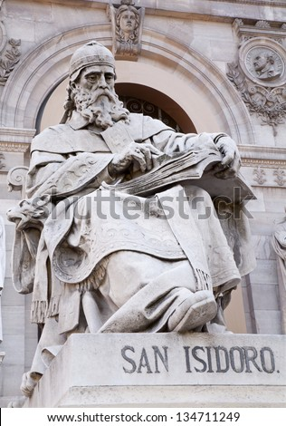 MADRID - MARCH 11: Saint Isidore of Seville from Portal of National Archaeological Museum of Spain projected by architect Francisco Jareno and built from 1866 to 1892 on March 11, 2013 in Madrid. - stock photo