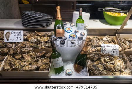Madrid - May 10: Stall with oysters in Mercado San Miguel on May 10, 2016 in Madrid, Spain. Mercado San Miguel of Madrid is one of the most popular landmark in Madrid, Spain.