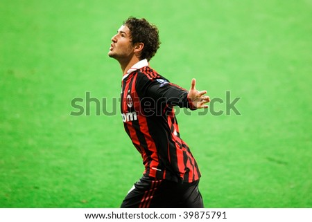 MADRID - OCT 21: AC Milan's Brazilian striker Alexandre Pato celebrates the winning goal of Milan's 3-2 victory over Real Madrid in Champions League action October 21, 2009 in Madrid, Spain. - stock photo